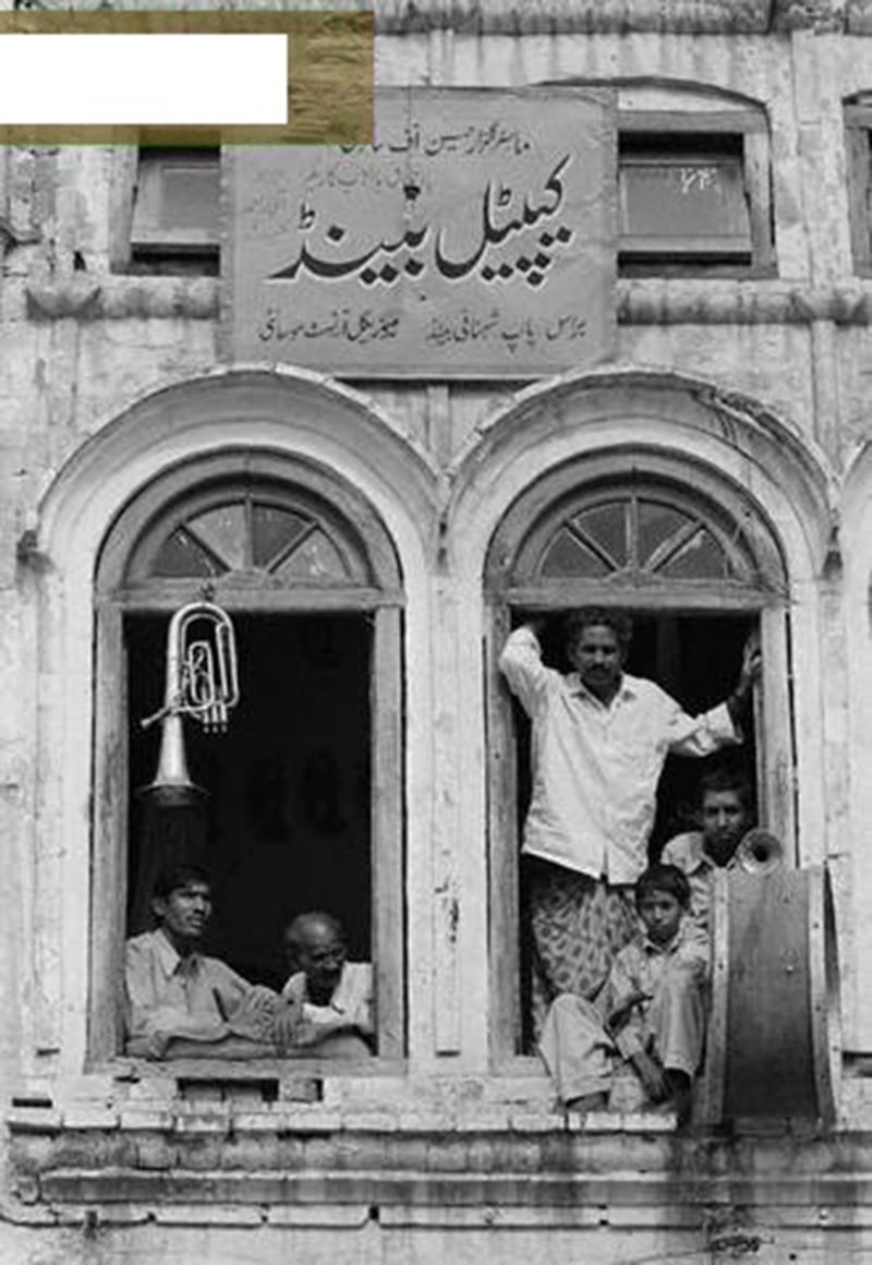 And the band looked on: A family of wedding musicians stand at the window of their home in Rawalpindi in 1977.