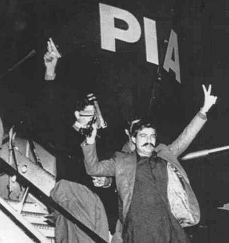Renegade: Notorious left-wing Pakistani terrorist, Salamullah Tipu, on the steps of the PIA plane that he hijacked (with three other radicals) in 1981. He escaped to Kabul where he was killed in 1984.