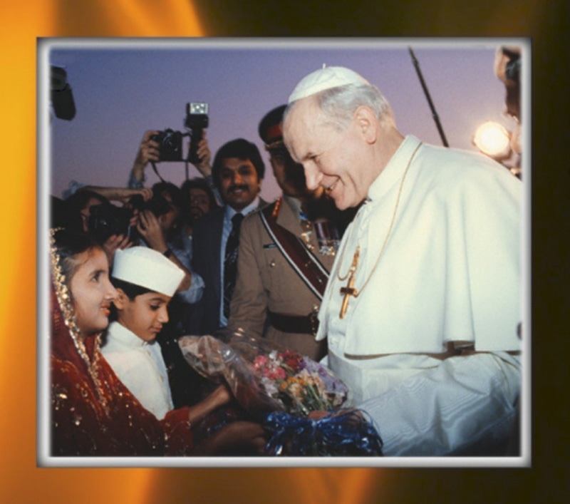 The Pope comes to town: Children present Pope John Paul II flower bouquets at the Karachi Airport in 1981. The Pope addressed a large gathering of Pakistani Catholics at Karachi's National Stadium.
