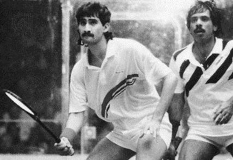 Two's a crowd: Pakistan squash players, Jahansher Khan and Jahangir Khan, battle it out in Karachi in 1989. Both ruled the game as world champions in the 1980s and early 1990s.