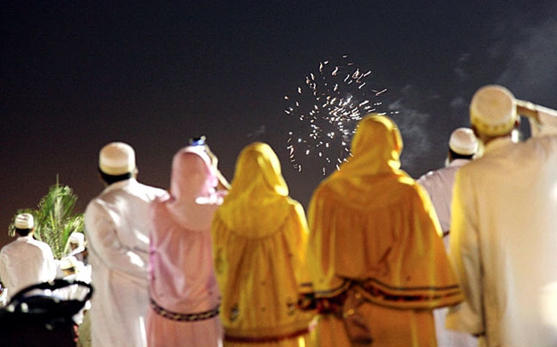 Men and women from Pakistan's Bohra community (a Shia sub-sect) watch fireworks in Karachi.