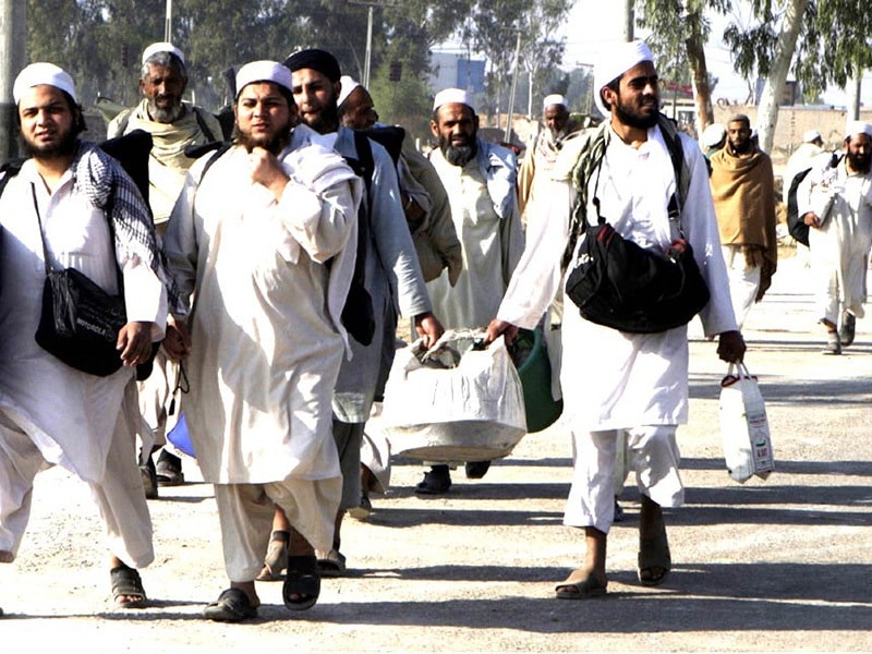 Members of the Tableeghi Jamat  (TJ) arrive in the organisation's headquarters in Raiwind. The TJ is the country's largest  apolitical Sunni Islamic evangelical outfit.