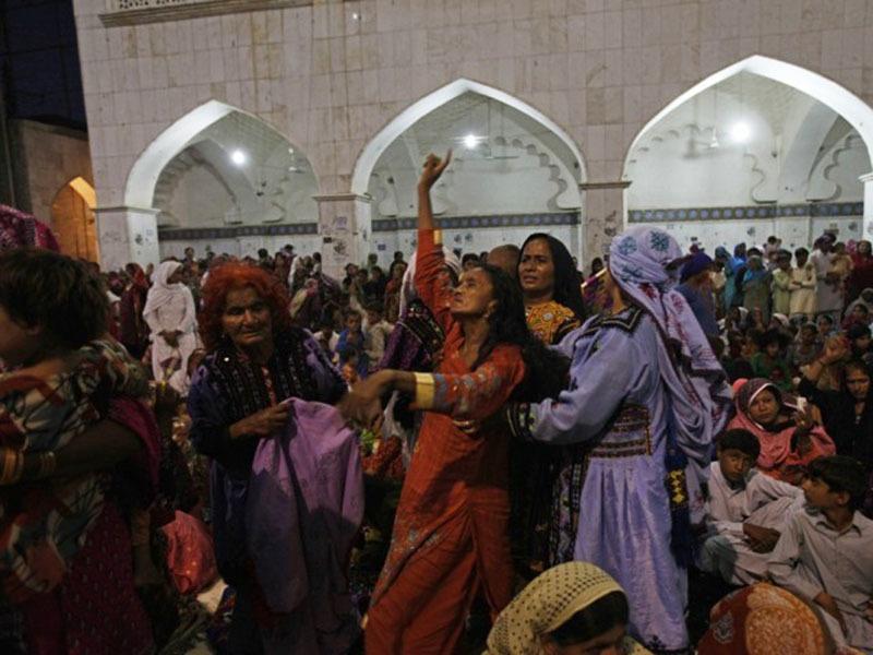 Women do the 'dhamal' outside the shrine of Sufi saint, Lal Shahbaz Qalandar in Shewan Sharif.
