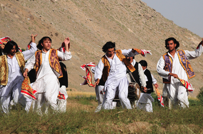 Pushtun men perform the Khattak dance in the hills of Swat.