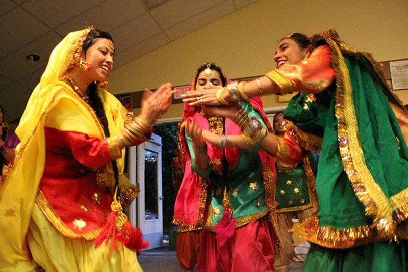 Punjabi women doing the Punjabi folk dance, the Luddi.