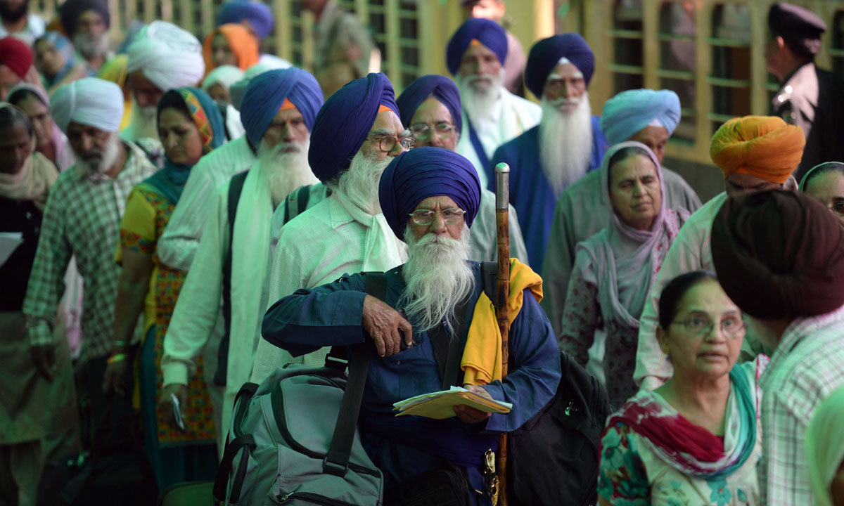 Indian Sikh pilgrims arrive at Wagah Railway Station in Wagah, to celebrate Baisakhi, or the Sikh New Year. – AFP/File