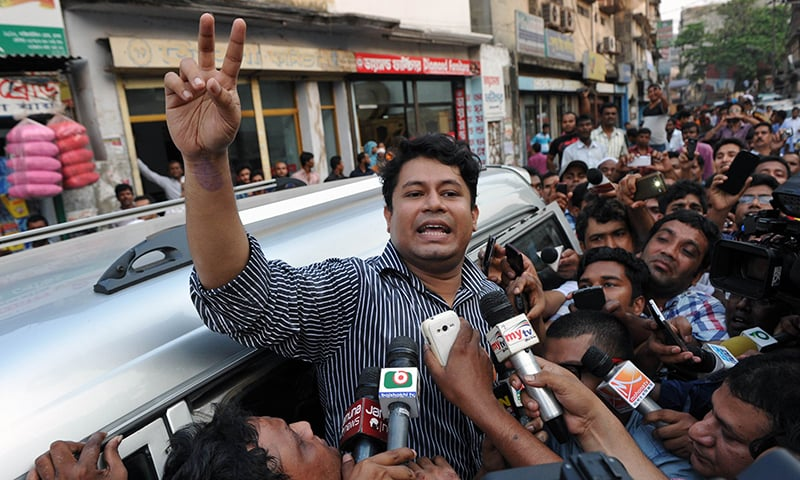 A relative of Kamaruzzaman shows the victory sign after a meeting him at the central prison in Dhaka. -AFP