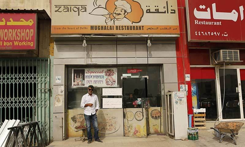 Shadab stands outside the restaurant.—AFP
