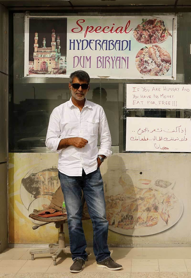 Shadab Khan, one of the Indian owners of the Zaiqa restaurant, poses for a photograph outside his restaurant in southern suburbs of the Qatari capital Doha.—AFP