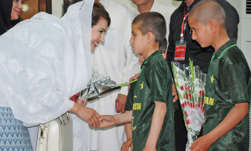 Reham Khan, wife of PTI chief Imran Khan, meets children at Chief Minister's House in Peshawar on Sunday. —Photo by Shahbaz Butt
