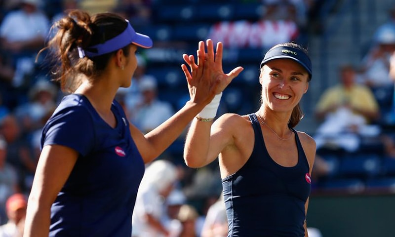 Sania Mirza won the Family Circle title in Charleston on Sunday partnering Swiss great Martina Hingis. — AFP