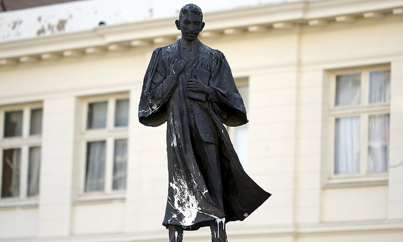 A statue of Mahatma Gandhi is seen after it was vandalized with white paint at Gandhi Square in Johannesburg April 13, 2015. — Reuters
