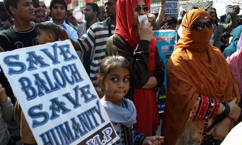 Relatives of missing persons march on road at Hyderabad press club as they participate in a rally organised by Voice of Baloch Missing Persons. - INP/File