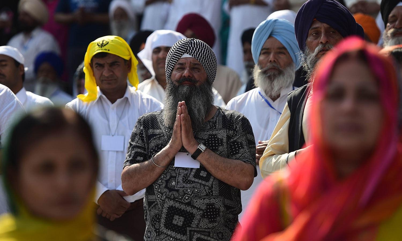 Pilgrims gather in prayer at the Gurdwara Panja Sahib. — AFP