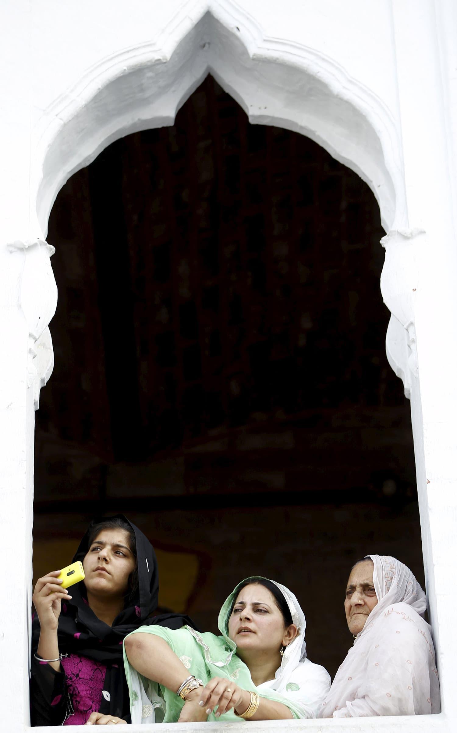Sikh devotees watch the Baisakhi festival at Panja Sahib shrine in Hassan Abdal.—Reuters
