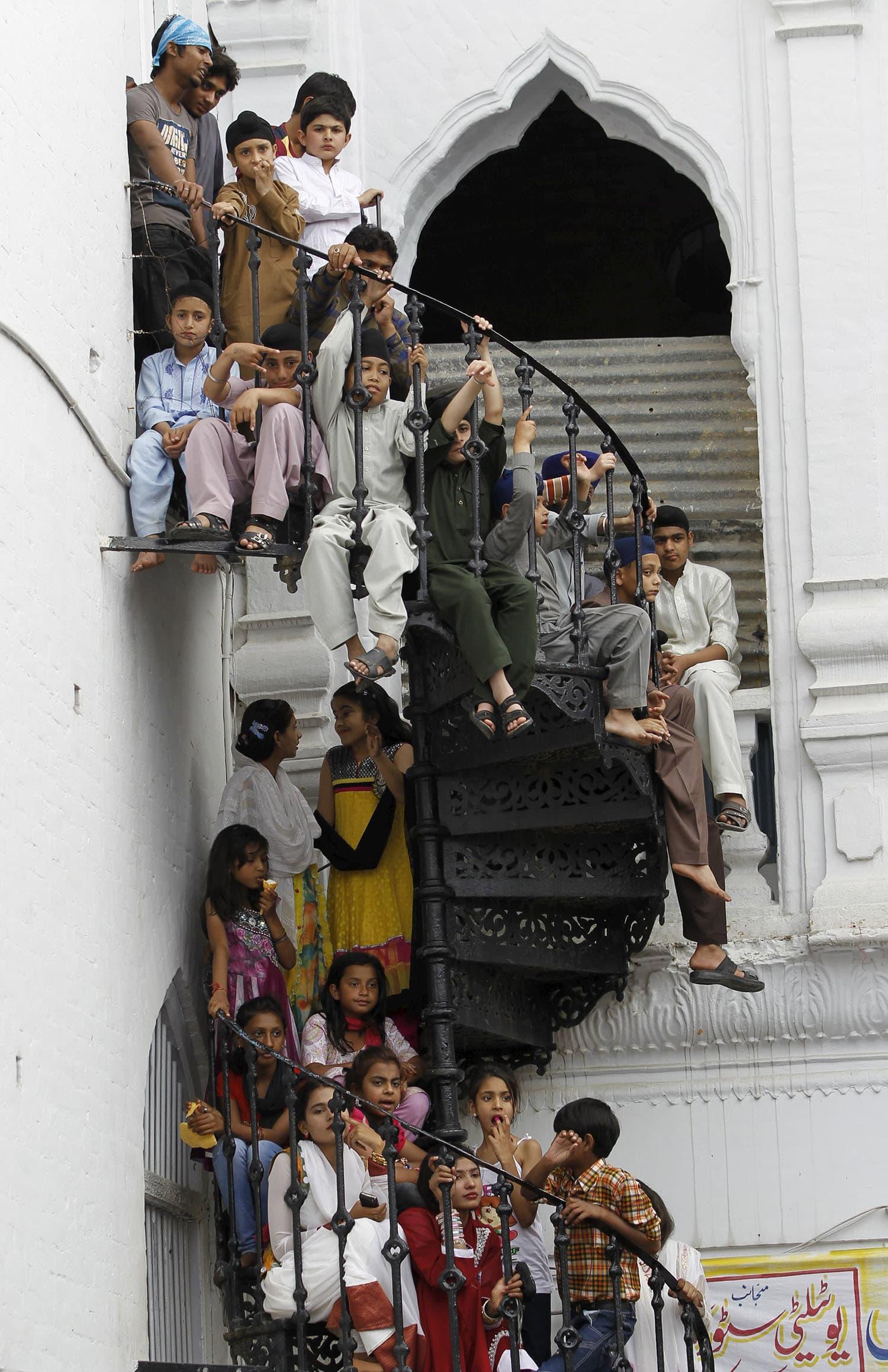 Children watch the Baisakhi festival at Panja Sahib shrine in Hassan Abdal.— Reuters