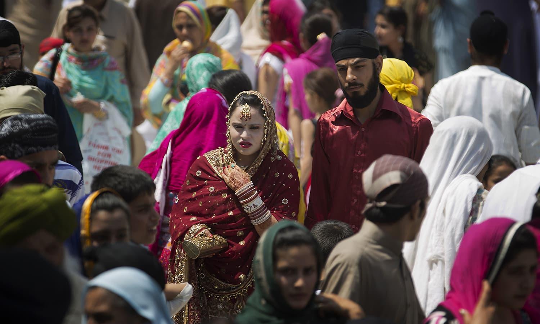 Pilgrims attend a religious festival at Panja Sahib shrine in Hasan Abdal.— AP