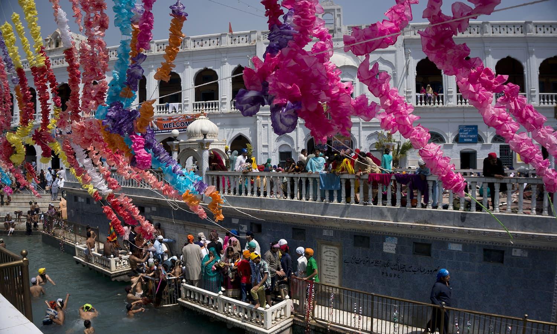 Sikh pilgrims attend a religious festival in Hasan Abdal. — AP