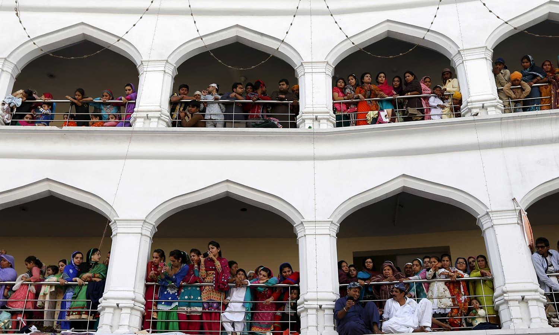 Sikh devotees watch the Baisakhi festival at Panja Sahib shrine. — Reuters