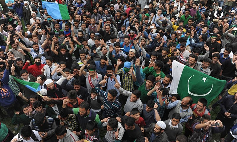 Kashmiris shout anti-India and pro-freedom slogans as Kashmiri  leader Syed Ali Shah Geelani addresses a rally on his return from New Delhi. AFP