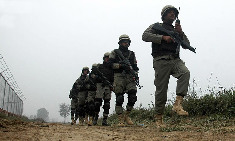 Pakistan Rangers' soldiers seen alert at Zero Line, Wagah Border as the security forces are on high alert on the border after shelling in Shakargarh Sector.— Online