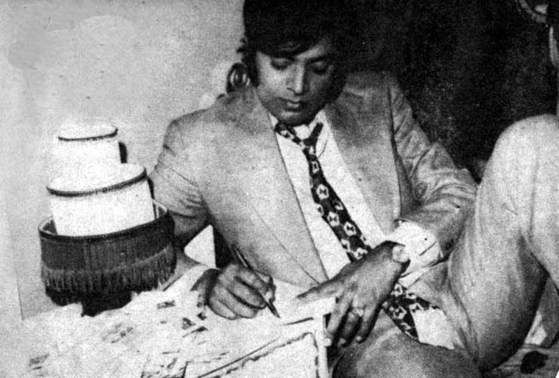 Murad signing autographs in Karachi in 1972.
