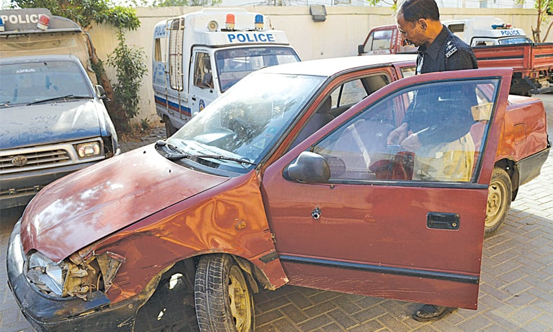 KARACHI: A policeman inspects the vehicle which the US citizen was driving when she was attacked.—AFP