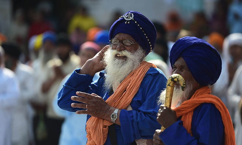 In this photograph taken on April 14, 2015, Sikh devotees attend final prayers at the Gurdwara Panja Sahib during the annual Baisakhi festival in the Pakistani town of Hasanabdal. — AFP