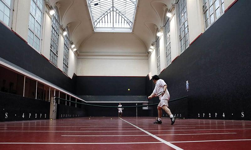 People play Real Tennis, the ancient sport ancestor of tennis, in Paris. — AFP
