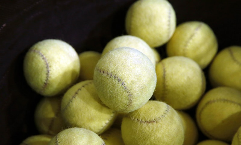 Real Tennis' ball, the ancient sport ancestor of tennis, are pictured here. — AFP