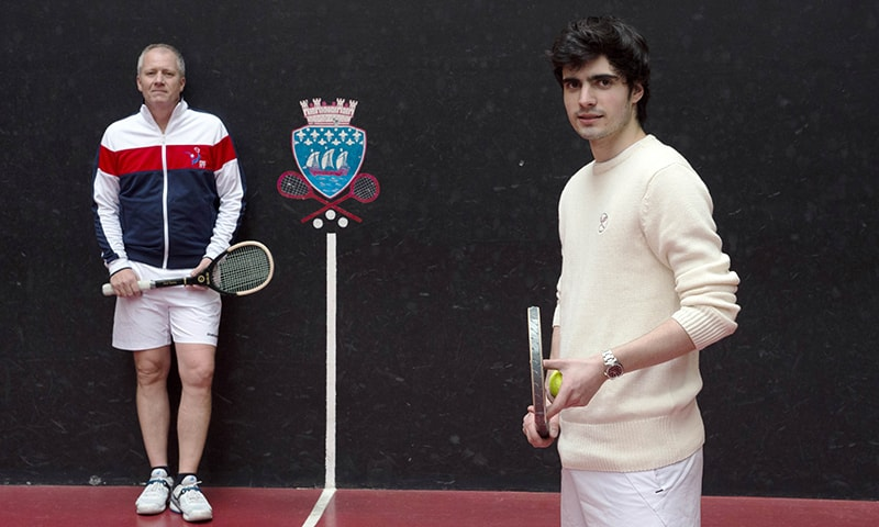 Matthieu Sarlangue, right, poses with his coach Tim Batten at the Real Tennis and Squash club in Paris. — AFP