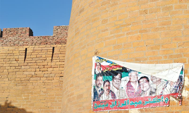 The hoof mark of Rana Ratan's mare above a political poster from recent times