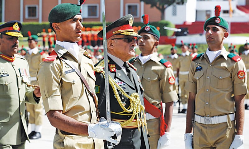 ABBOTTABAD: Gen Sher Mohammad Karimi, the Afghan Army's Chief of General Staff, reviews the passing-out parade at the Pakistan Military Academy, Kakul, on Saturday.—White Star