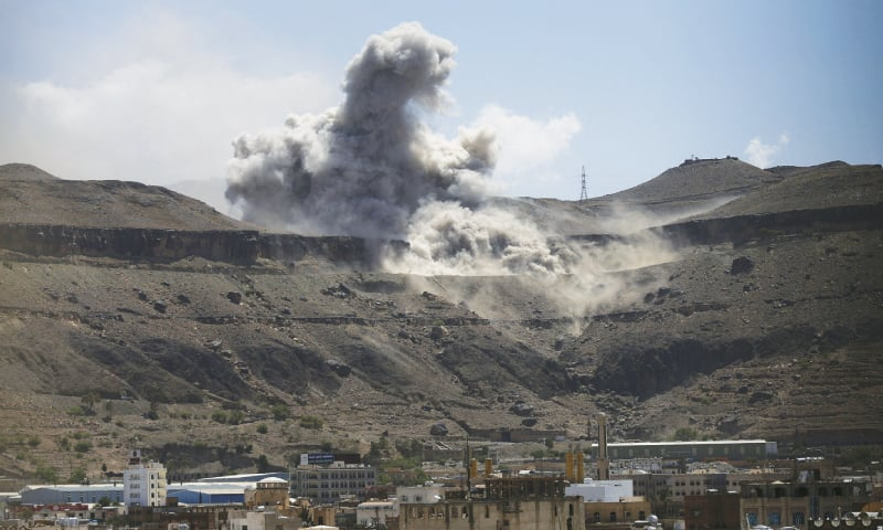 Sanaa: Dust rises from the site of an army weapons depot hit by an air strike on Saturday.—Reuters