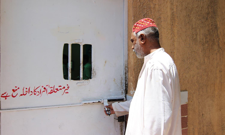Kazim Raza opens the door of the Fine Arts school.