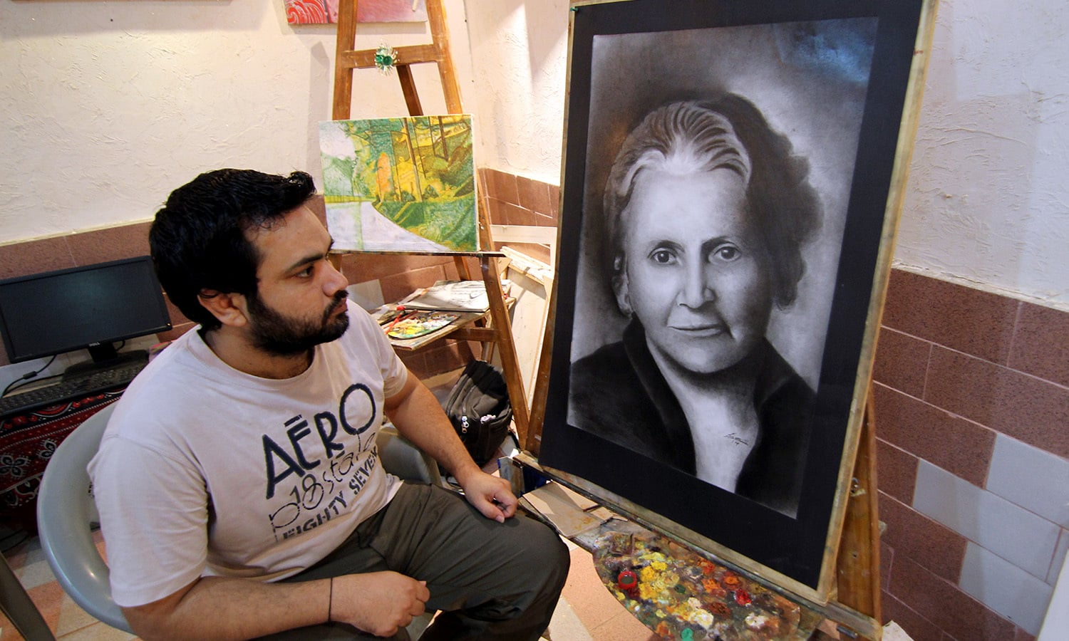 Samar Abbas, 33, has been convicted for murder and is serving a 25-year sentence. In this picture he sits next to one of his finished sketches.