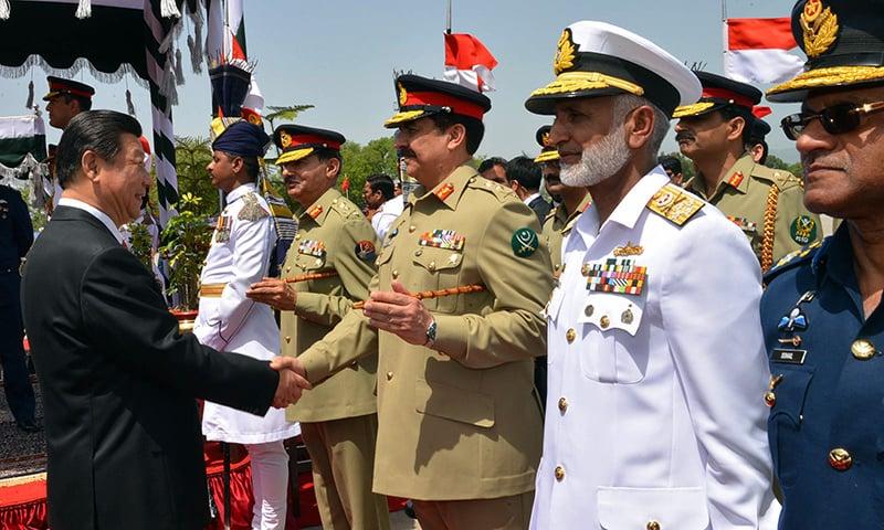 COAS Gen Raheel Sharif welcomes Mr Jinping. —AFP