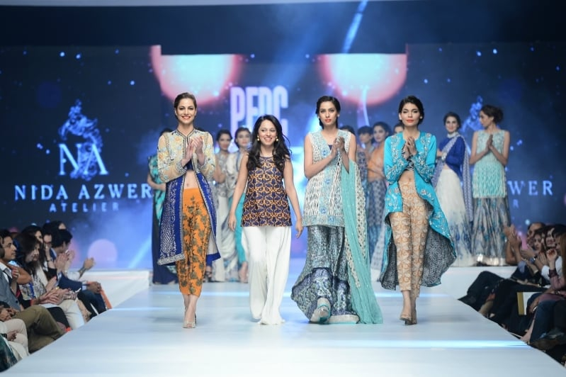 Nida walks beside her models. - Photo: Faisal Farooqui and his team at Dragonfly