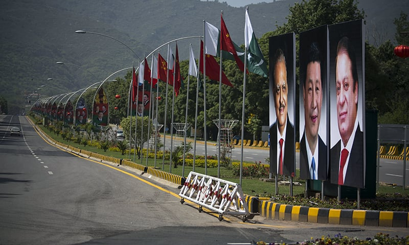 Billboard with pictures of Chinese President Xi Jinping are on display in Islamabad. —AP