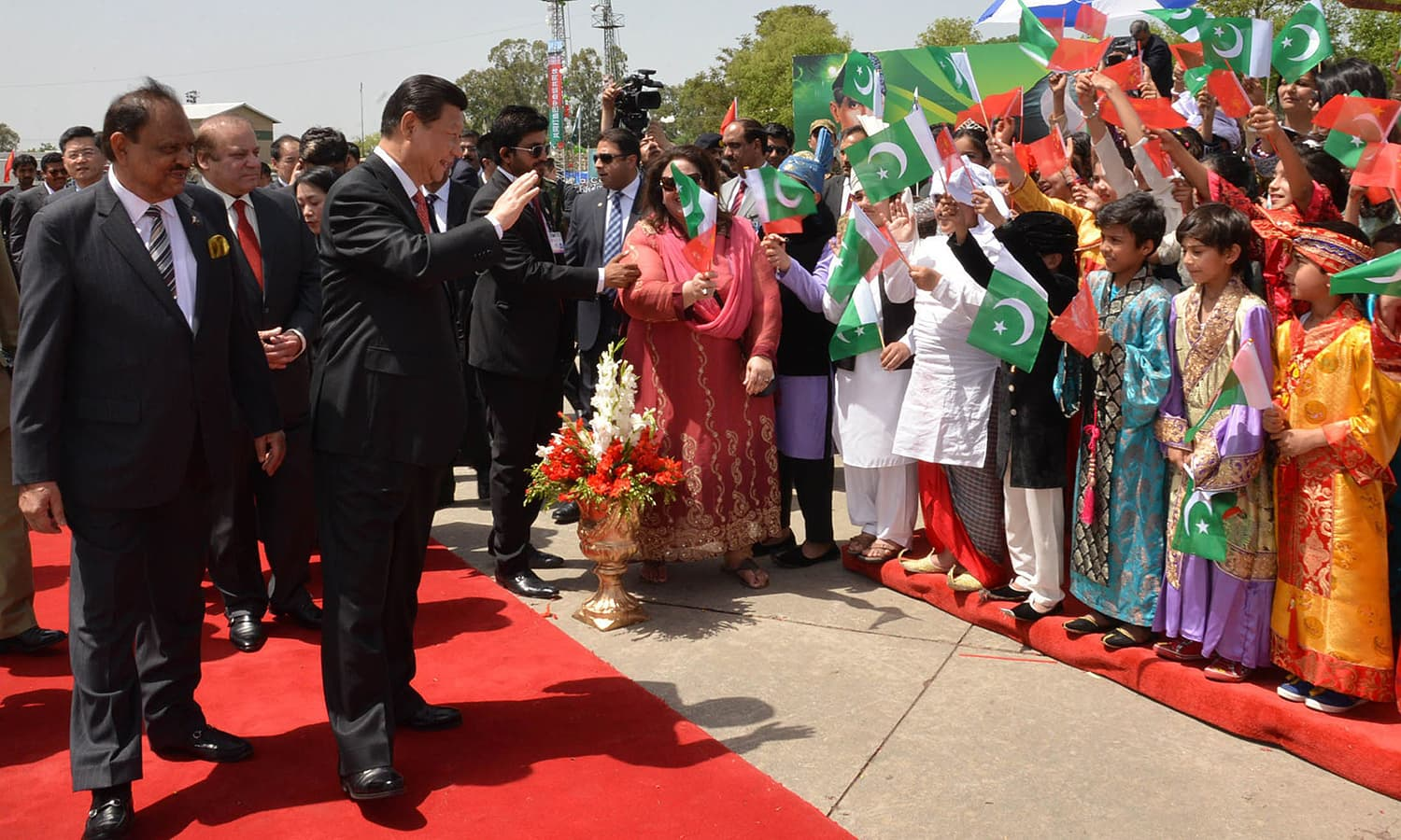 Children clad in colourful traditional clothes waved Pakistani and Chinese flags and sang anthems of Pakistan-China friendship as the Chinese President and the first lady passed by. — AFP