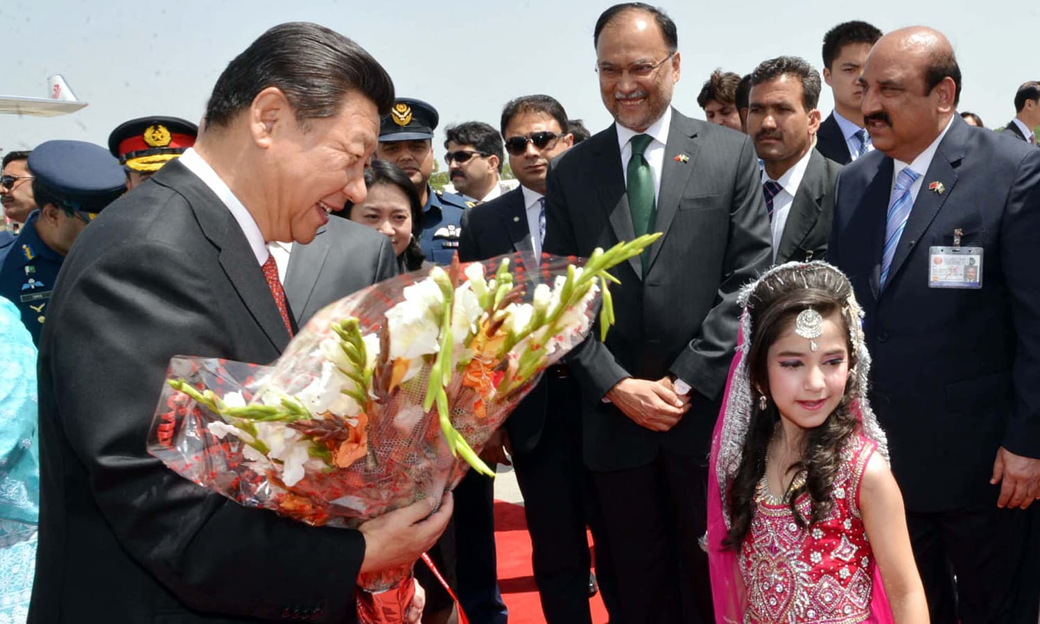 President of People Republic of China, Xi Jinping is presented a bouquet upon his arrival at Nur Khan Air Base. — PPI