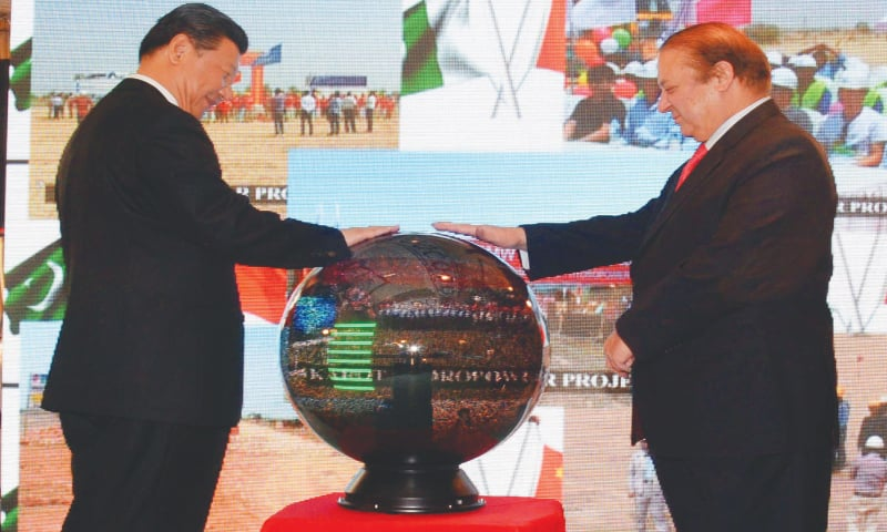 PRIME Minister Nawaz Sharif and Chinese President Xi Jinping inaugurate projects through video link at the Prime Minister Office on Monday.—White Star