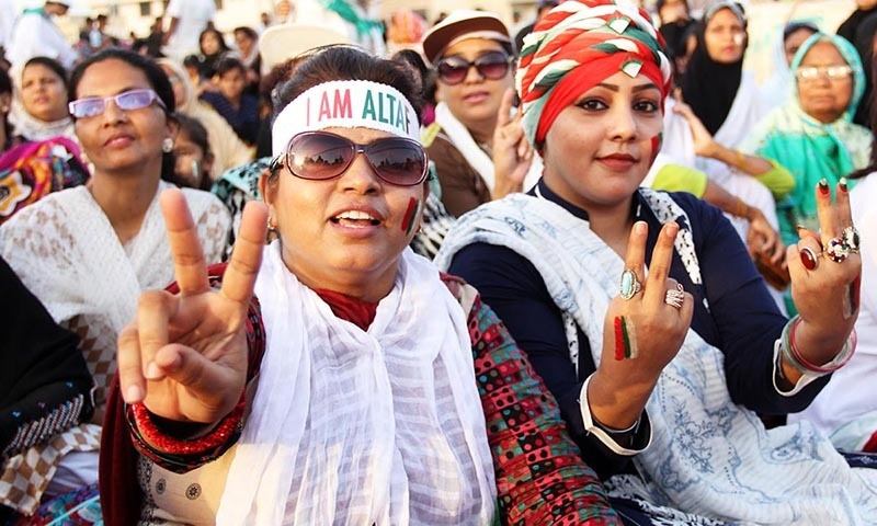 MQM supporters showing victory sign as the party shows its political strength during public gathering of election campaign in NA-246.— Online
