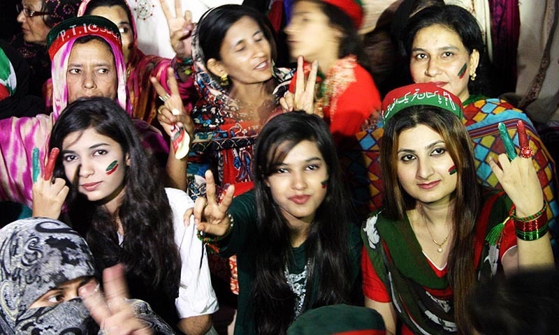 Supporters of Pakistan Tehreek-i-Insaf showing victory sign during public gathering at Shahrah-e-Pakistan during election campaign in NA-246  constituency of Karachi.— Online