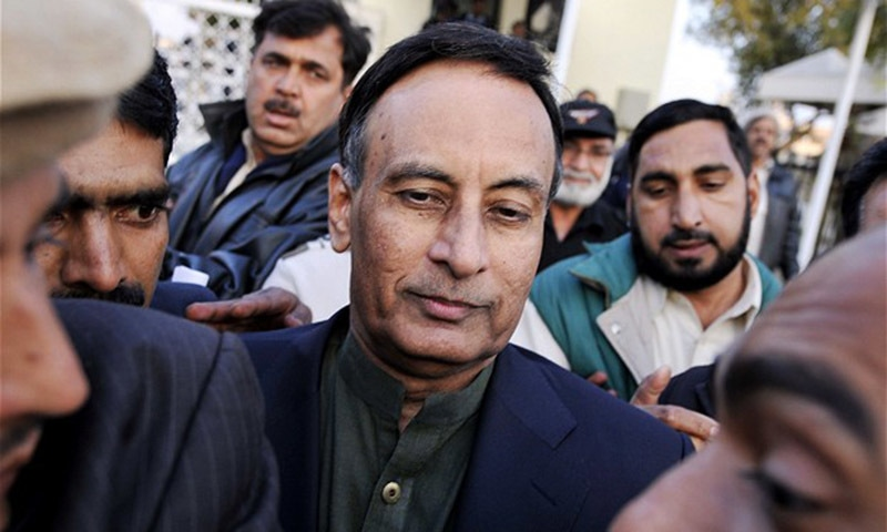 Pakistan's former ambassador to United States Husain Haqqani (C) exits the Supreme Court after meeting his lawyer Asma Jehangir, in Haqqani's defence in the secret memo scandal case, in Islamabad on December 22, 2011. — AFP/file