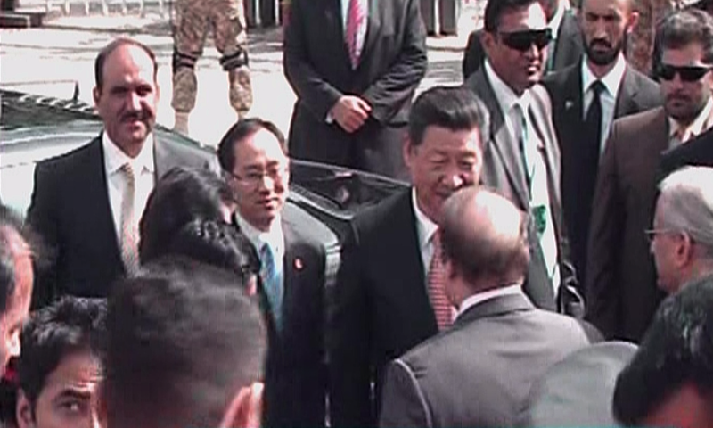 President Jinping meets Prime Minister Sharif upon arriving at the parliament. — DawnNews screengrab