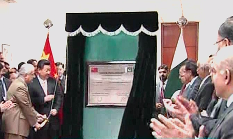 Mr Jinping inaugurated a 1.2MW project for providing electricity to the Parliament building through solar energy. — DawnNews screengrab