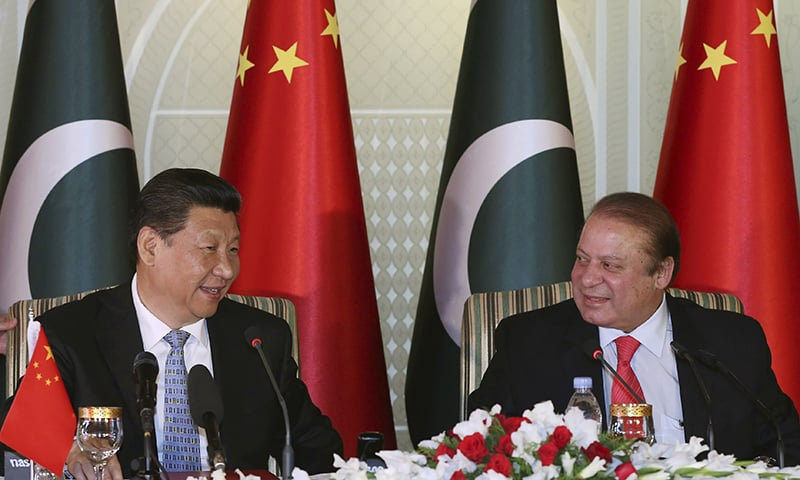 Chinese President Xi Jinping, left and Prime Minister Nawaz Sharif attend a press conference after their talks in Islamabad. — AP
