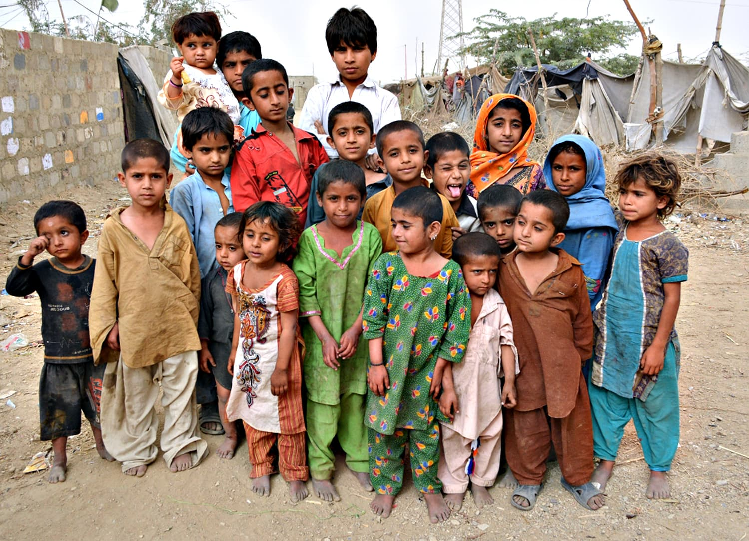 A group of children pose for the camera in Karachi's Sindhabad slum.