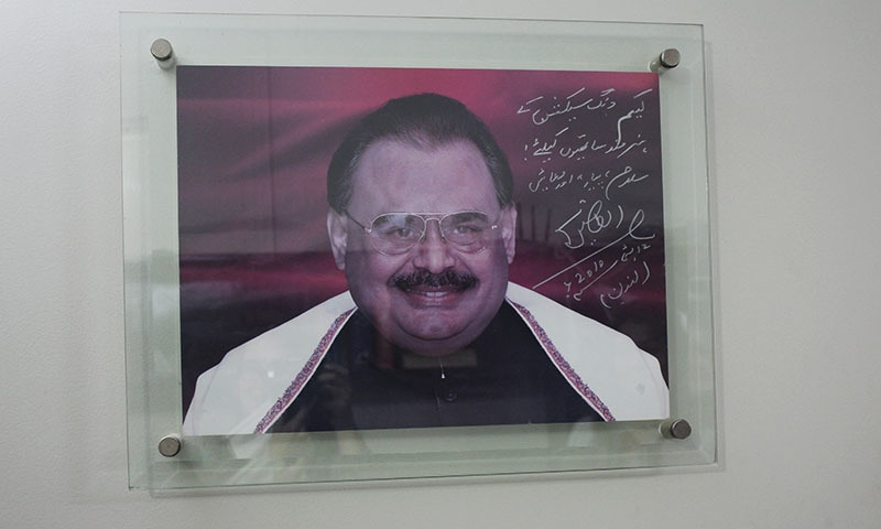 Altaf Hussain sent a signed photo to the MQM's social media team, which now hangs in their office — Photo by author